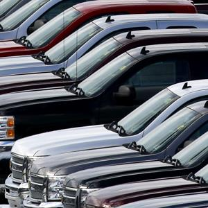 Chevy trucks line the lot of a dealer in Murrysville, Pa. on January 9, 2013 (© Gene J. Puskar/AP Photo)