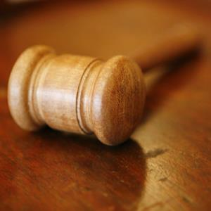 Gavel on a table (copyright Lee Thompson/Getty Images)