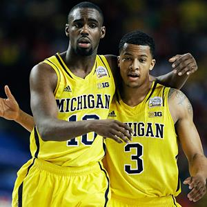 Michigan's Trey Burke & Tim Hardaway Jr. during the NCAA semifinal game in Atlanta on Saturday (© Charlie Neibergall/AP)