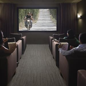 People watching a movie in a home theater (copyright Andersen Ross/Photographer's Choice/Getty Images)
