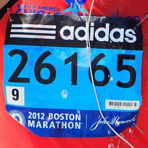 File photo of Boston Marathon runner's bib (© Dina Rudick/The Boston Globe via Getty Images)