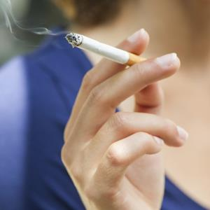Woman holding cigarette (copyright Michele Constantini/PhotoAlto/Getty Images)