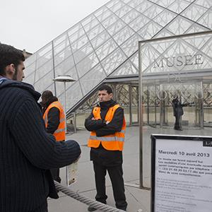 A visitor stands in front of the entrance to the closed Louvre museum in Paris, France, Wednesday, April 10, 2013 (© Jacques Brinon/AP Photo)