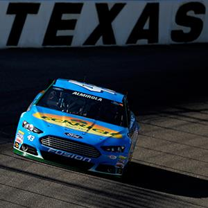Aric Almirola drives the #43 Eckrich Ford during NASCAR Sprint Cup Series Gen-6 Testing at Texas Motor Speedway in Fort Worth, Texas (copyright Sean Gardner/Getty Images for NASCAR)