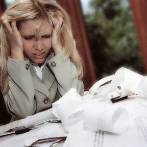 Image: Woman with paperwork ( Corbis)