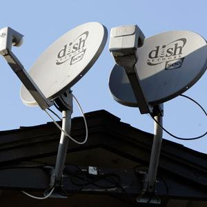 File photo of three Dish Network satellite dishes, on the roof of an apartment complex in Palo Alto, Calif. on Feb. 23, 2011 (© Paul Sakuma/AP)