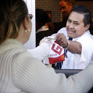 Marino Ahuatl works the drive through station at a McDonalds in Wheaton, Ill. ( Antonio Perez/Chicago Tribune/MCT via Getty Images)