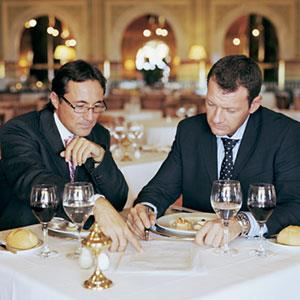 Image: Businessmen at lunch (© Digital Vision/Getty Images)