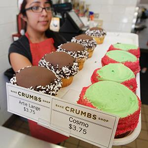 An employee holds a tray of cupcakes at a Crumbs Bake Shop in Hollywood, Calif. ( Fred Prouser/Newscom/Reuters)