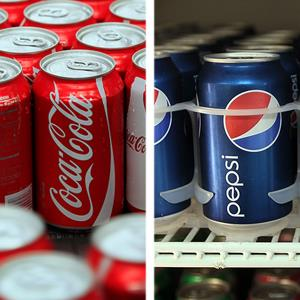 Cans of Coca-Cola; Cans of Pepsi ( George Frey/Bloomberg via Getty Images; Joe Raedle/Getty Images)