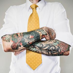 Businessman with tattooed arms ( RyanJLane/E+/Getty Images)