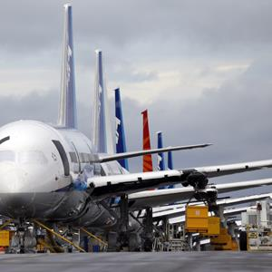 A line of Boeing 787 jets are parked nose-to-tail at Paine Field Tuesday, Feb. 5, 2013, in Everett, Wash. ( Elaine Thompson/AP Photo)