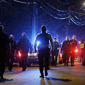 Police officers walk near a crime scene during the early morning hours Friday, April 19, 2013, in Watertown, Mass. (Matt Rourke/AP Photo)