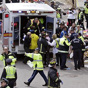 Medical workers aid injured people at the finish line of the 2013 Boston Marathon in Boston, Monday, April 15, 2013 (© Charles Krupa/AP Photo)