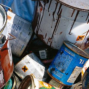Paint cans in a landfill (Johner Images/Alamy)