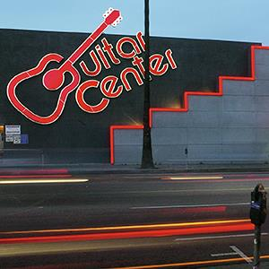 File photo of a Guitar Center store on Sunset Boulevard in Los Angeles (Damian Dovarganes/AP Photo)