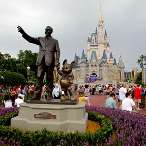 File photo of visitors walking on Main Street at Walt Disney World on June 5, 2012, in Lake Buena Vista, Fla. (© John Raoux/AP)