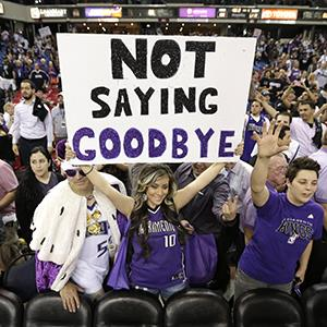 Adriana Ortiz, center, holds up a sign during the Kings's game against the Los Angeles Clippers in Sacramento, Calif. on April 17, 2013 (© Rich Pedroncelli/AP Photo)