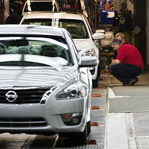 Workers inspect a new Nissan Altima on the line at the Nissan plant in Smyrna, Tenn. (copyright Erik Schelzig/AP Photo)