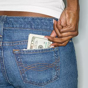 Image: Money in pocket (© Tom Grill/Corbis)