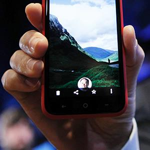 An HTC First phone showing the new app Facebook Home for Android during a press event in Menlo Park, Calif. on April 4, 2013 (© Robert Galbraith/Newscom/Reuters)