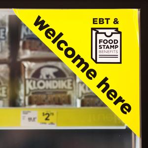 A sign on a frozen food case indicates that Electronic Benefit Transfer (EBT) and food stamps are accepted at the Dollar General Corp. store in Saddle Brook, New Jersey, U.S., on Saturday, Dec. 3, 2011. Emile Wamsteker/Bloomberg via Getty Images