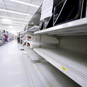 Empty shelves in a New Jersey Wal-Mart ( Najlah Feanny/Corbis)