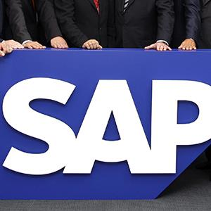 Board members of German software company SAP stand behind the company logo at their headquarter in Germany on July 31, 2008 (© Daniel Roland/AP Photo)