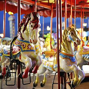 Carousel at an amusement park (© Driendl Group/Photodisc/Getty Images)