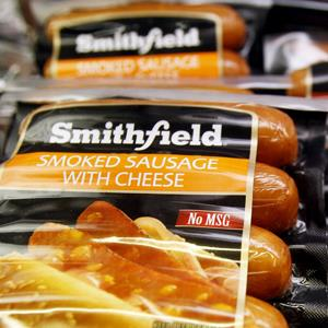 File photo of smoked sausage from Smithfield Foods Inc. in a grocery store in Zelienople, Pa. on March 4, 2011 (© Keith Srakocic/AP Photo)