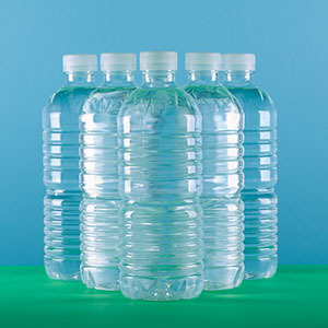 Bottled water (© Grove Pashley/Corbis)
