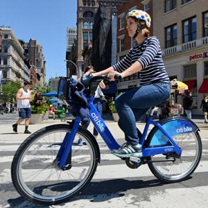 A couple ride their Citi Bike bicycles from a station near Union Square as the bike sharing system is launched May 27, 2013 in New York