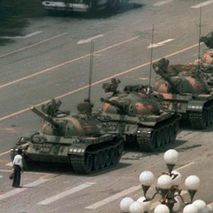 A Chinese man stands alone to block a line of tanks heading east on Beijing's Cangan Blvd. in Tiananmen Square on June 5, 1989 (© Jeff Widener/AP Photo)
