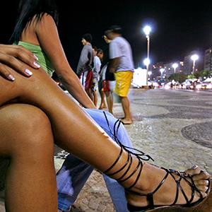 File photo of prostitutes working in the Copacabana neighborhood of Rio de Janeiro, Brazil during the Pan American Games on July 15, 2007 (© Douglas Engle/Bloomberg via Getty Images)