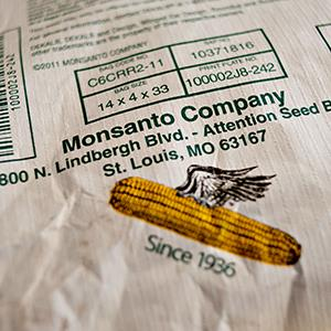 File photo of a Monsanto Co. seed bag sitting on a palate at a farm in Princeton, Illinois on April 3, 2013 (© Daniel Acker/Bloomberg via Getty Images)