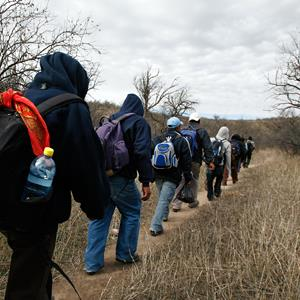 A group of immigrants walk through the desert towards the U.S. border, near Sasabe, Mexico, on February 14, 2008 (© Alexandre Meneghini/AP)