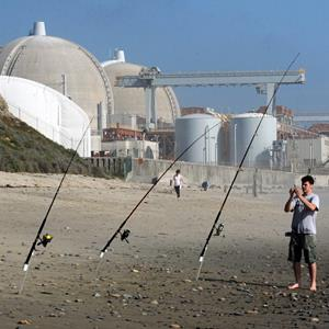 A fisherman stands beside the San Onofre Nuclear Power Plant in San Diego, Calif., on March 15, 2011 (© Mark Ralston/AFP/Getty Images)