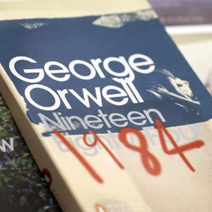 An edition of '1984' by George Orwell, right, is displayed among other Penguin books (© Chris Ratcliffe/Bloomberg via Getty Images)