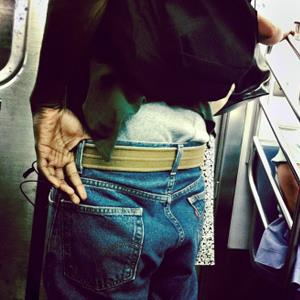 Boy with baggy pants on subway (© Keith Goldstein/Photographer's Choice RF/Getty Images)