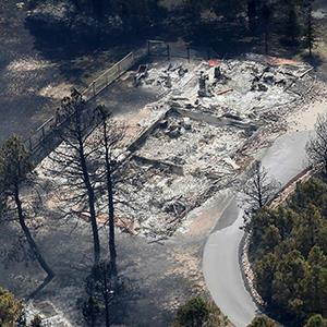 An aerial view of a destroyed house in the aftermath of the Black Forest Fire in Black Forest, Colorado on June 13, 2013 (© Rick Wilking/Newscom/Reuters)