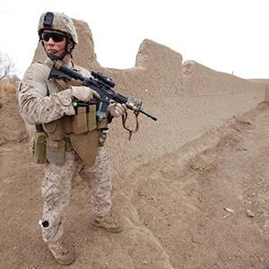 A United States Marine holding an M4 Carbine during a combat operation in Marjah, Helmand Province of Afghanistan on Nov. 12, 2012 (© Ed Darack/SuperStock/Corbis)
