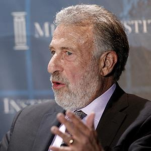 File photo of George Zimmer, founder and executive chairman of The Men's Wearhouse Inc., on May 1, 2012 (© Patrick Fallon/Bloomberg via Getty Images)