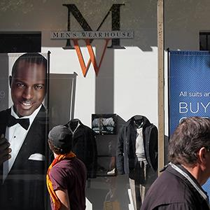 People walk past a Men's Wearhouse store on November 2, 2011 in Oakland, Calif. (© Justin Sullivan/Getty Images)