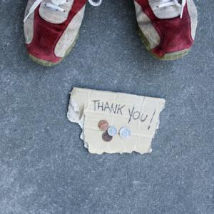 Sneakers next to coins & 'Thank You' sign (© Fuse/Getty Images)