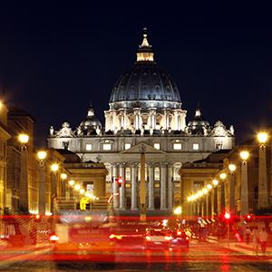 St. Peter's Basilica in Vatican City is seen illuminated at night from Rome, Italy, on July 5, 2012 (© Alessia Pierdomenico/Bloomberg via Getty Images)