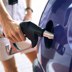 Filling up gas tank (copyright Corbis)