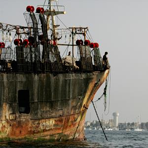 A Chinese fishing vessel caught fishing illegally waits in the Peruvian port of Callao, on November 24, 2004 (© Mariana Bazo/Reuters)