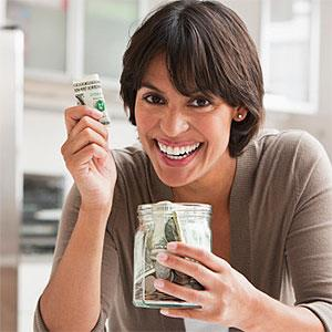 Woman with jar of cash © SelectStock, the Agency Collection, Getty Images