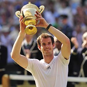 Britain's Andy Murray raises the winner's trophy after beating Serbia's Novak Djokovic at the 2013 Wimbledon Championships tennis tournament on July 7, 2013 (© GLYN KIRK/AFP/Getty Images)