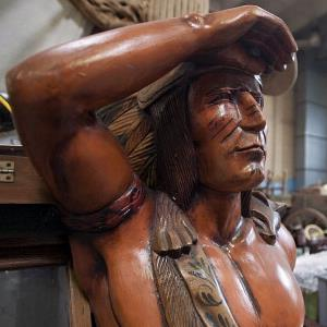 A wooden Indian statue meant for a Wild West museum sits in storage in Harrisburg, Penn., on October 28, 2011 (© Paul Taggart/Bloomberg via Getty Images)